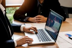 Finance trade manager showing reports screen analysis finance cu Royalty Free Stock Images