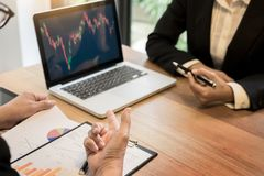 Finance trade manager showing reports screen analysis finance cu Stock Photo