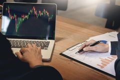 Finance trade manager showing reports screen analysis finance cu Royalty Free Stock Photography