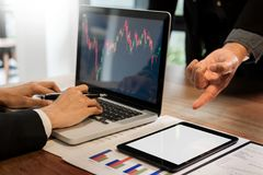 Finance trade manager showing reports screen analysis finance cu Stock Photos