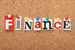 Finance. The word Finance in cut out magazine letters pinned to a cork notice board Royalty Free Stock Photography