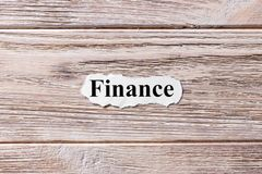 FINANCE of the word on paper. concept. Words of FINANCE on a wooden background royalty free stock photo