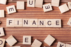 FINANCE word written on wood block. wooden abc Royalty Free Stock Photography
