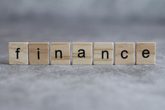 Finance word written on wood cube Royalty Free Stock Photography