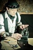 Financeiro na tabela com arithmometer Fotografia de Stock Royalty Free