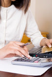 Finances. Young lady doing her finances at home Stock Photos