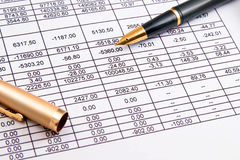 Finances. A  pen and financial statement Stock Photos