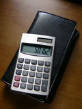 Finances. Calculator on checkbook royalty free stock photos