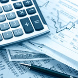 Finances. Dealing with finances and a calculator and cash Stock Image