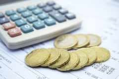Finances. Euro coins with calculator blured Royalty Free Stock Photos
