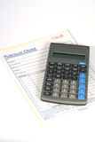 Finances. Purchase order form with a calculator Royalty Free Stock Photo