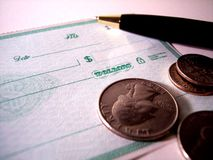 Finances. Blank check with coins and pen stock images