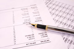 Finances and balances with pen. Counting finances and balances with pen stock photography