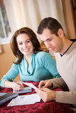 Finances: Couple Paying Bills Together Stock Images
