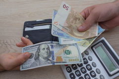 Finances, currency, business and people concept - close up of male and female hands giving or exchanging money. Finances, currency, exchange rate, business and royalty free stock image