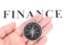 Finances et compas de titre photos stock