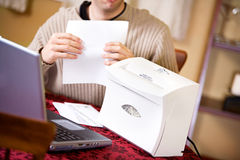 Finances: Man Ready To Shred Private Financial Documents Royalty Free Stock Photography