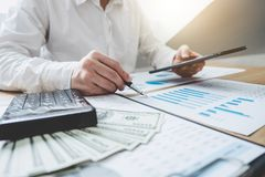 Finances Saving Banking Concept, Man accountant calculations inc. Ome on digital tablet and analyzing financial graph data with calculator stock image