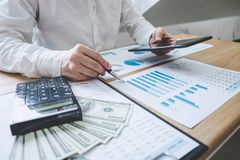 Finances Saving Banking Concept, Man accountant calculations income on digital tablet and analyzing financial graph data with. Calculator royalty free stock photo
