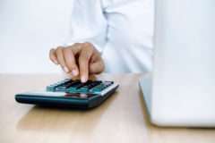 Finances Saving Economy concept. Female accountant or banker use Stock Photography