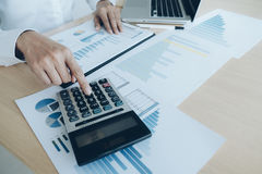 Finances Saving Economy concept. Female accountant or banker use Royalty Free Stock Image