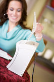 Finances: Woman Shredding Sensitive Financial Documents Stock Photo