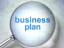 Financiënconcept: Businessplan met optisch glas Royalty-vrije Stock Foto's