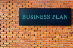 Financiënconcept: De tekst van het Businessplan op bakstenen muurachtergrond Royalty-vrije Stock Afbeeldingen