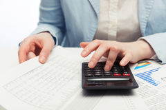 Financial accounting business woman using calculator stock photo