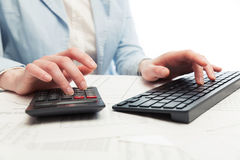 Financial accounting Business woman using computer keyboard Stock Photo
