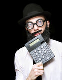 Financial And Accounting Genius With Calculator Stock Photo