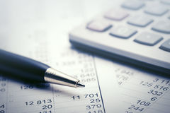 Financial accounting. Pen and calculator Stock Photography