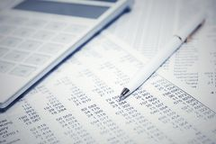 Financial accounting pen and calculator stock photo