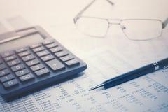 Financial accounting. Pen and calculator on balance sheets stock photos