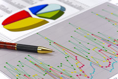 Financial accounting with pen and chart stock image