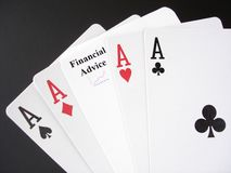 Financial Advice Gamble. Poker Aces and a Financial Advice card, white on black Royalty Free Stock Photography