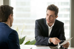 Financial adviser consulting businessman, discussing contractual Stock Photo