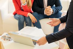 Financial adviser consulting young couple stock photography