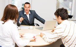 Financial adviser and his customers stock images