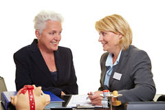 Financial adviser with senior woman Stock Photography