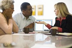 Financial Advisor Assisting Couple Royalty Free Stock Photography