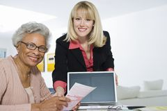 Financial Advisor Assisting Senior Woman Royalty Free Stock Photo