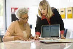 Financial Advisor Assisting Senior Woman Stock Photography