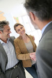 Financial advisor and clients handshaking after successful agreement Royalty Free Stock Images