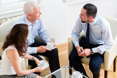 Financial advisor consulting couple in retirement planning Royalty Free Stock Photography