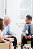 Financial advisor consulting couple in retirement planning Stock Photo