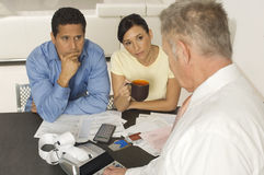 Financial Advisor In Discussion With Clients Stock Photos