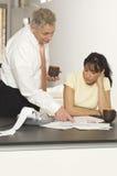 Financial Advisor Explaining Document To Woman Stock Image