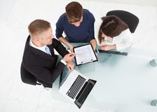 Financial advisor explaining investment plan to couple Royalty Free Stock Images