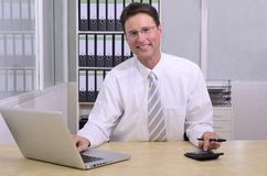 Financial advisor at office Stock Images